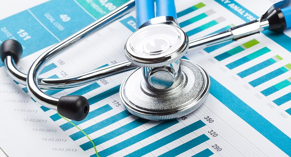 Stethescope on top of medical charts