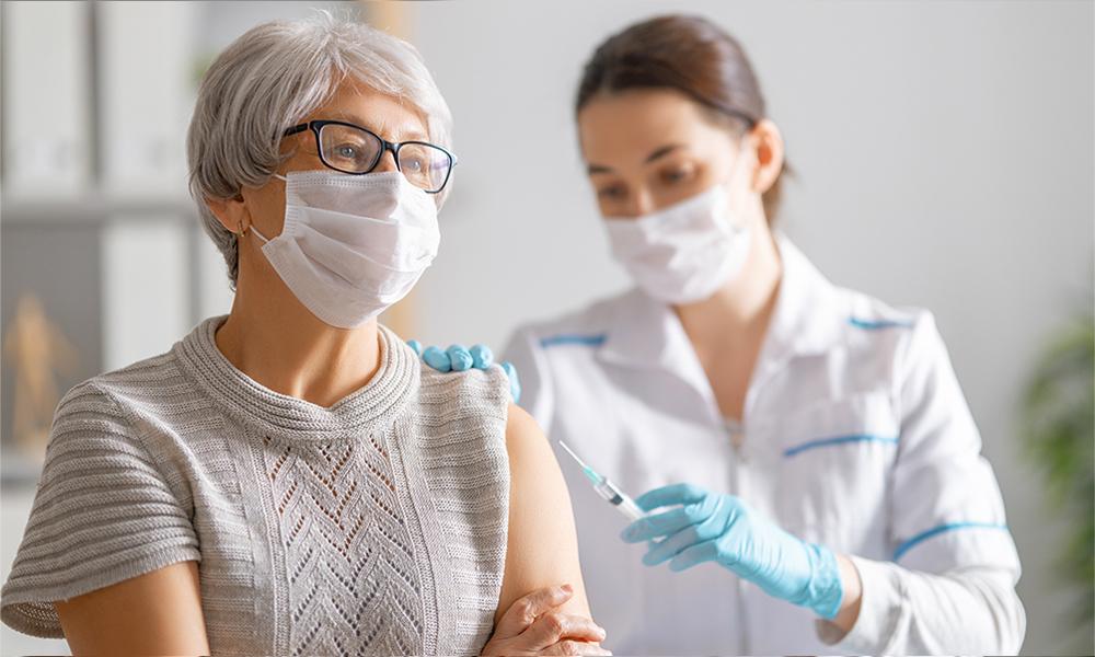 Woman receiving vaccine at health practice